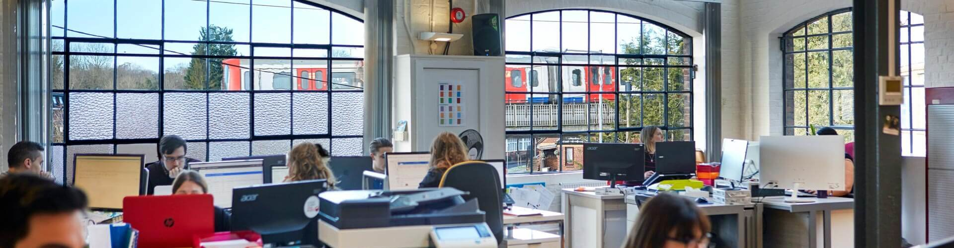 the upriseUP office featuring the tube train